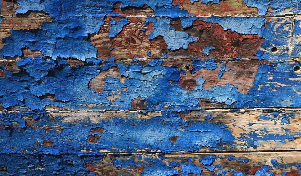 cracked paint on wooden wall surface